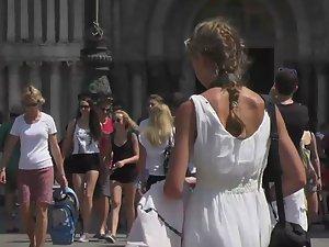 Cute girl in a white summer dress