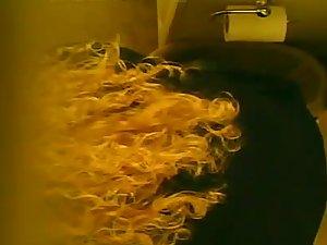 Hidden cam on the toilet ceiling